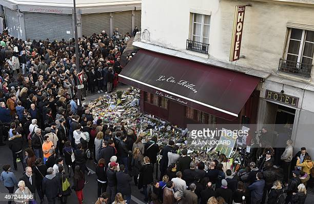 Mourners gather in front of 'Le carillon' restaurant on November 16 in the 10th district of Paris following a series of coordinated terrorists...