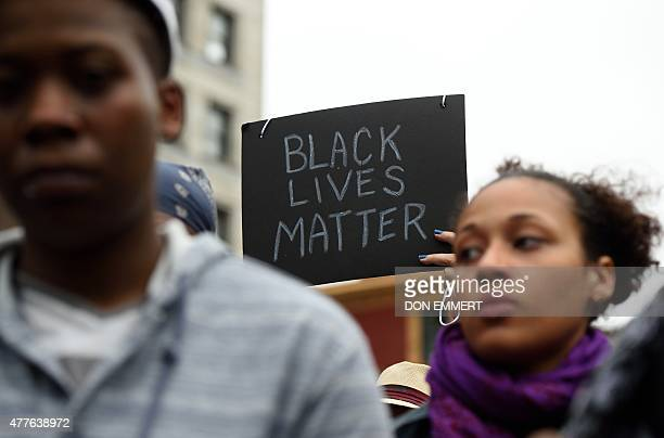 Mourners gather in Union Square Park June 18 2015 in New York in to remember those killed at a prayer meeting in Charleston South Carolina US police...