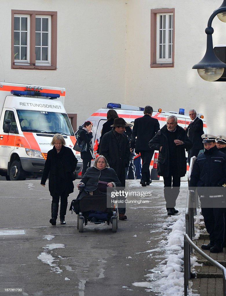 Mourners gather outside of Muenster St. Jakobus church as a memorial service is held for 14 people who died in a fire at a Caritas employment facility for the handicapped on December 1, 2012 in Titisee-Neustadt, Germany. The fire was reportedly caused by an explosion at the facility, where approximately 120 people with disabilities are employed in light manufacturing.