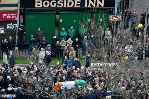 Mourners gather outside The Bogside Inn The funeral cortege passes through the streets of Derry on March 23 2017 in Londonderry Northern Ireland The...