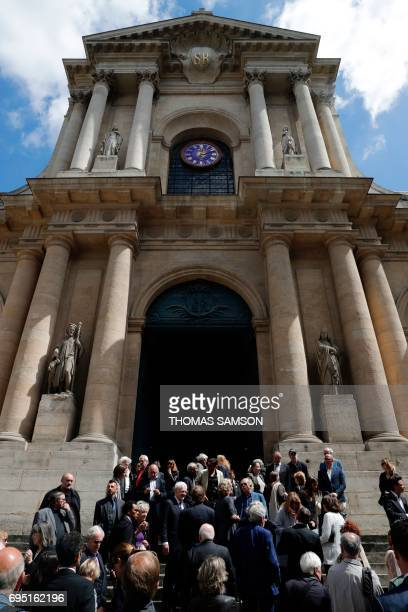 Mourners gather outside the SaintRoch Church in Paris during the funeral of French actor JeanMarc Thibault on June 12 2017 / AFP PHOTO / THOMAS SAMSON