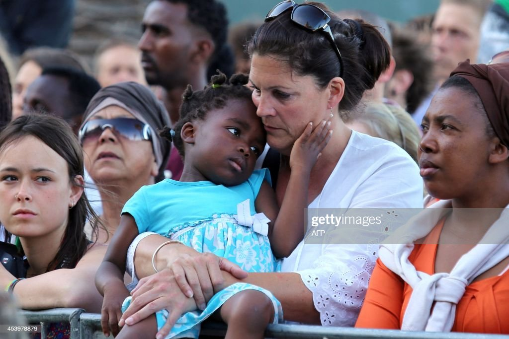 Mourners gather to honour late South African former president Nelson Mandela at an inter-faith service on December 6, 2013, held at the Grand Parade in Cape Town, where Mandela made his first speech as a free man in 1990. Mandela, the revered icon of the anti-apartheid struggle in South Africa and one of the towering political figures of the 20th century, died in Johannesburg on December 5 at age 95. Mandela, who was elected South Africa's first black president after spending nearly three decades in prison, had been receiving treatment for a lung infection at his Johannesburg home since September, after three months in hospital in a critical state.
