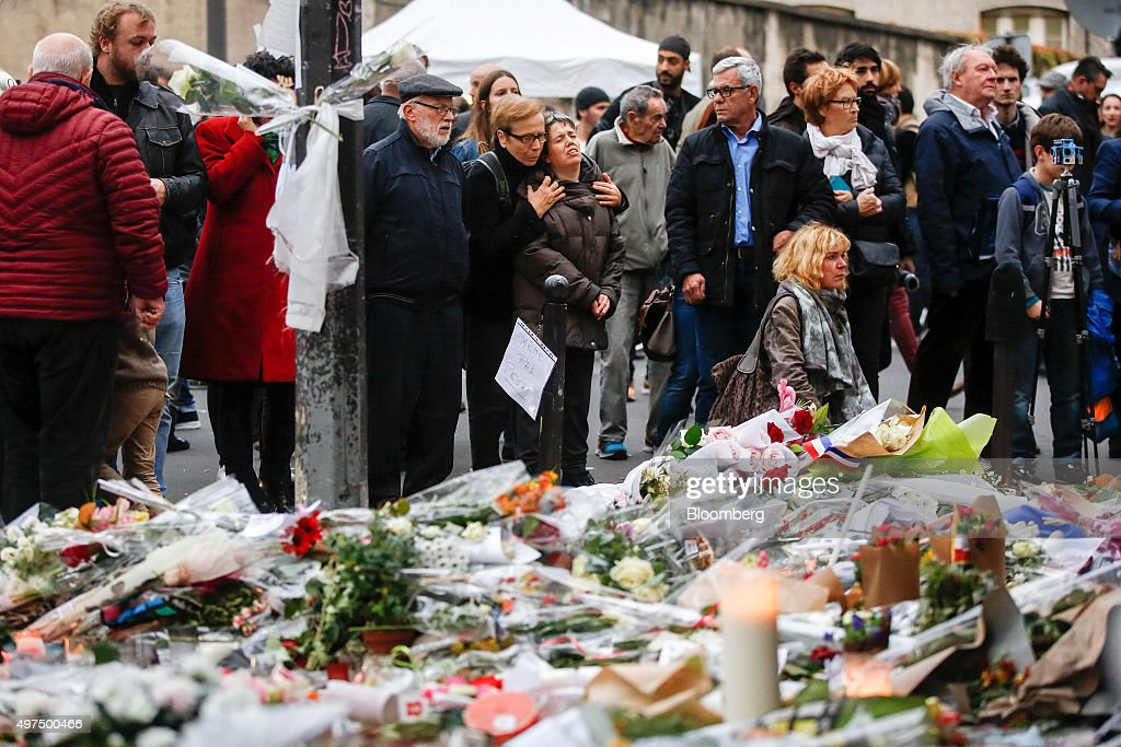 Mourners gather to pay their respects at the Le Carillon restaurant the site of one of Friday's terror attacks in Paris France on Monday Nov 16 2015...