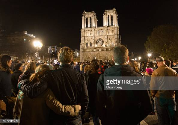 Mourners gather to pay their respects to victims of the terrorist attacks at the Notre Dame Cathedral in Paris France on Sunday Nov 15 2015 French...