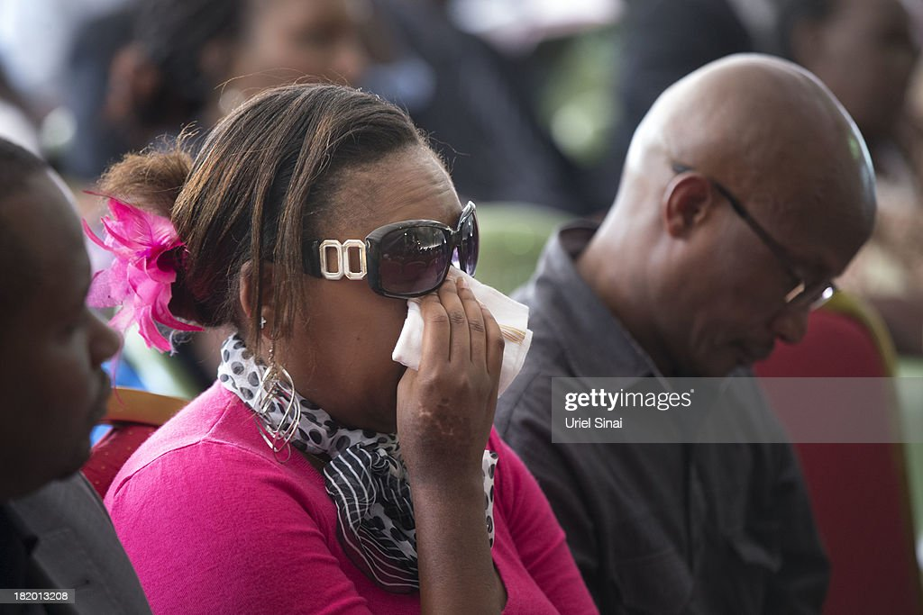 Mourners greive at a funeral service for Kenyan President Uhuru Kenyatta's nephew Mbugua Mwangi and his fiancee Rosemary Wahito who were killed at the the Westgate Mall terrorist attack, on September 27, 2013 in Nairobi, Kenya. The country is observing three days of national mourning as security forces begin the task of clearing and securing the Westgate shopping mall following a four-day siege by militants.