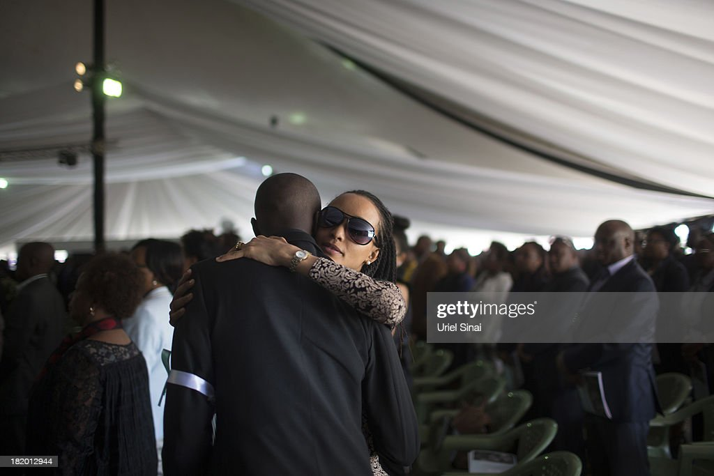 Mourners grieve at a funeral service for Kenyan President Uhuru Kenyatta's nephew Mbugua Mwangi and his fiancee Rosemary Wahito who were killed at the the Westgate Mall terrorist attack, on September 27, 2013 in Nairobi, Kenya. The country is observing three days of national mourning as security forces begin the task of clearing and securing the Westgate shopping mall following a four-day siege by militants.