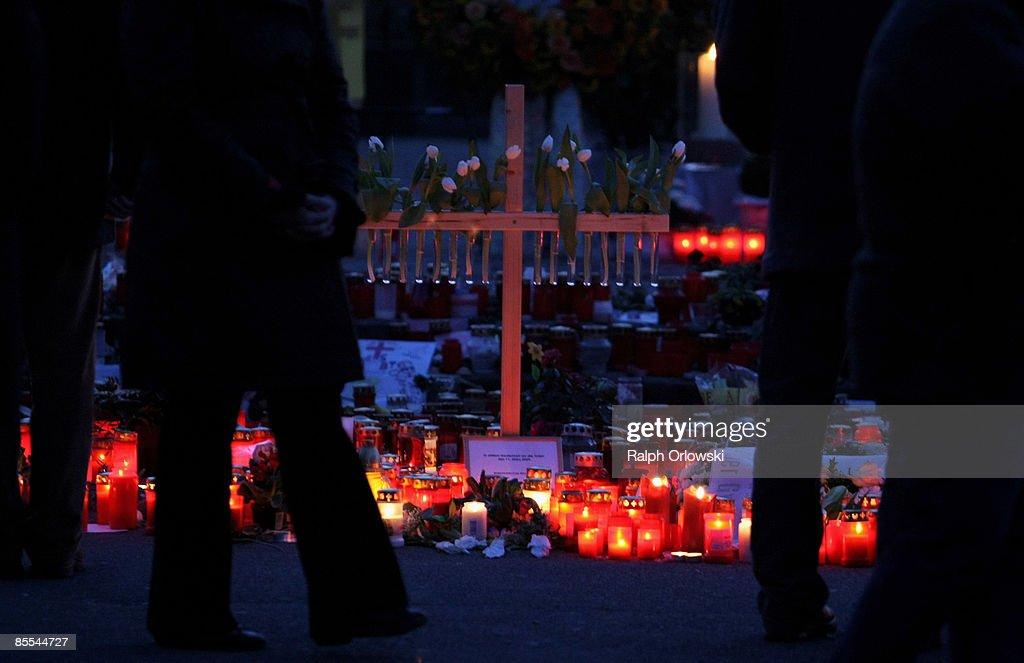 Mourners have placed a cross amid candles outside the high school during the day of a memorial service on March 21, 2009 in Winnenden near Stuttgart, Germany. President Koehler, Chancellor Merkel and thousands of mourners hold a memorial ceremony to commemorate the victims of a school shooting. 17 - year old Tim Kretschmer opened fire on Wednesday, March 11, 2009 on teachers and pupils at his former school, killing 15 people and leaving many more injured. Kretschmer fled the scene and shot himself dead after being cornered by police.