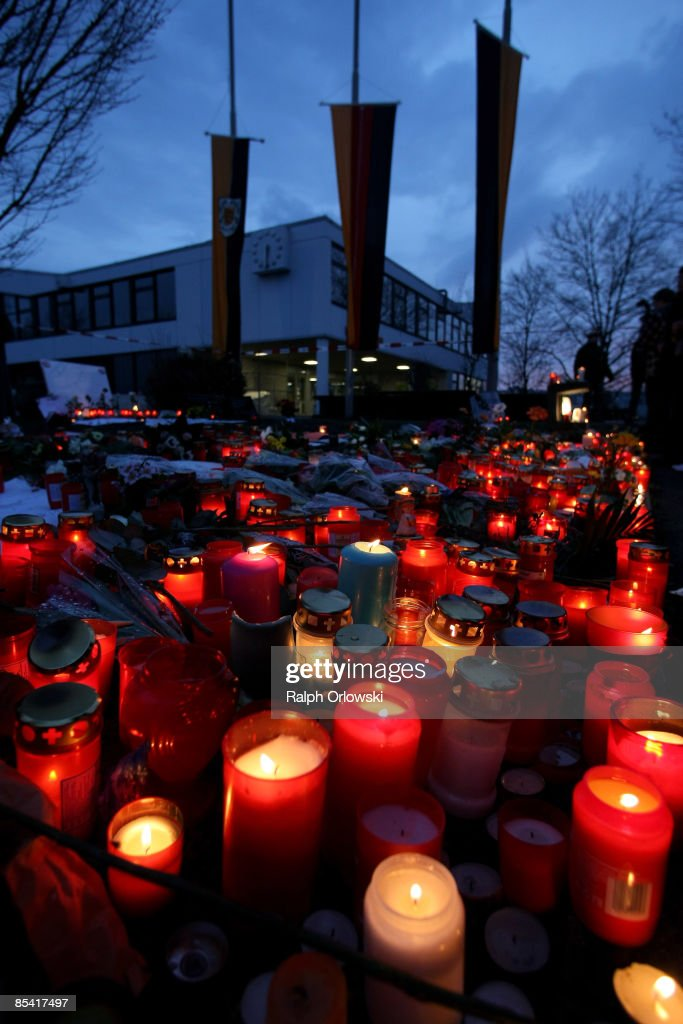 Mourners have placed candles outside the high school on March 13 2009 in Winnenden Germany 17 year old Tim Kretschmer opened fire on Wednesday March...