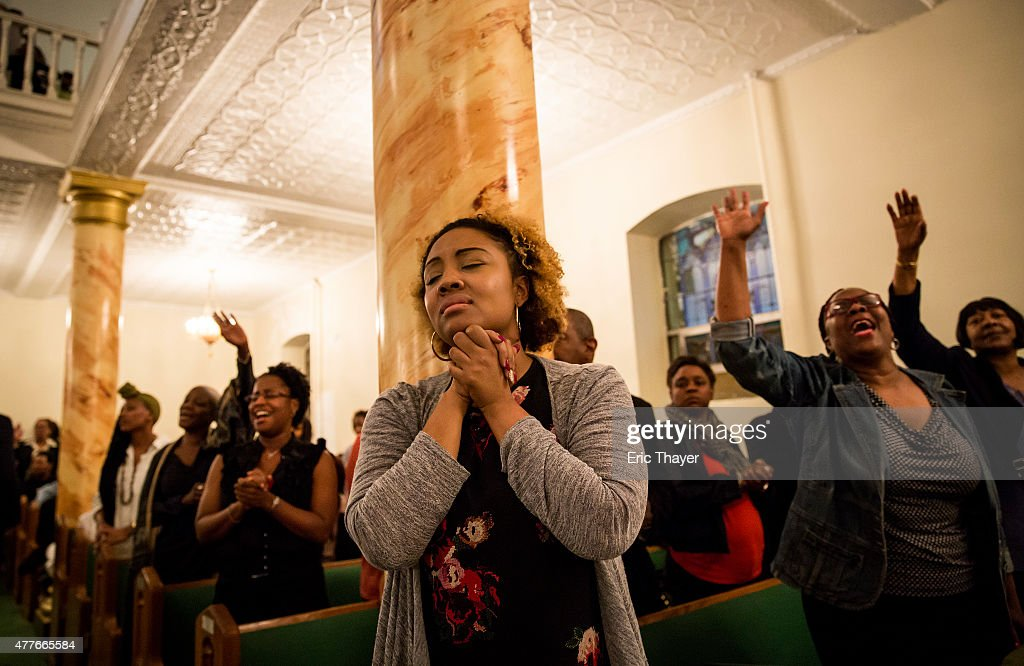 Mourners hold a prayer vigil for the nine victims of last night's shooting at the historic Emanuel African Methodist Episcopal Church in Charleston...