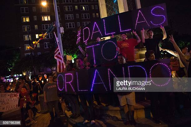 Mourners hold an LED sign reading 'Dallas To Orlando' during a vigil in Dallas Texas on June 12 for victims of the attack at Orlando's Pulse...