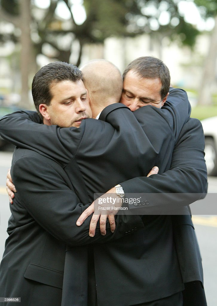 Mourners hug during the memorial service at Saint Monica's Catholic Church held for actor/dancer Gregory Hines on August 13, 2003 in Santa Monica, California.
