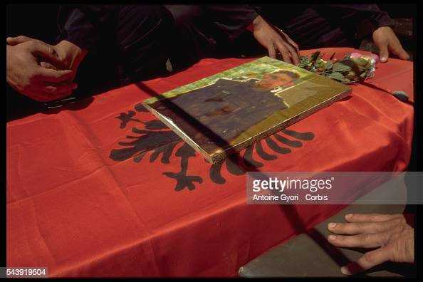 Mourners in Rogova Kosovo stand over the coffin of a Kosovo Liberation Army soldier who was killed during the Yugoslavian Civil War In the late 1990s...