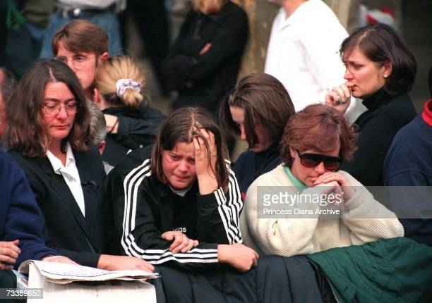 Mourners in the crowd gathered on the Mall for the Princess of Wales' funeral 6th September 1997