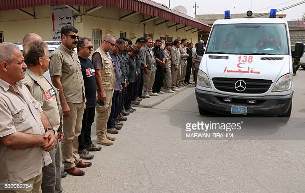 Mourners including employees of the Mines Advisory Group nongovernmental organisation which specialises in clearing landmines and unexploded ordnance...