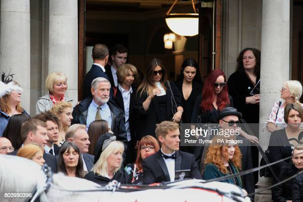 Mourners including Kym Marsh Helen Worth and Kate Oates leave the funeral service of Martyn Hett who was killed in the Manchester Arena bombing at...