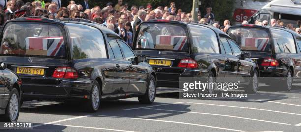 Mourners join friends and families of Guardsman Craig Roderick and Guardsman Apete Saunikalou Ratumaiyale Tuisovurua of the 1st Battalion the Welsh...