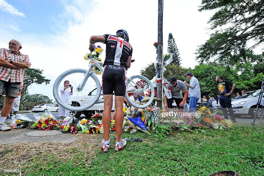 Mourners lay flowers at the sight of the accident where Burry Stander lost his life on January 6, 2012 in Balito South Africa. Burry was hit by a taxi while out on a training ride, he suffered severe head trauma and a broken neck, he was killed on impact. The taxi driver has been charged with culpable homicide.