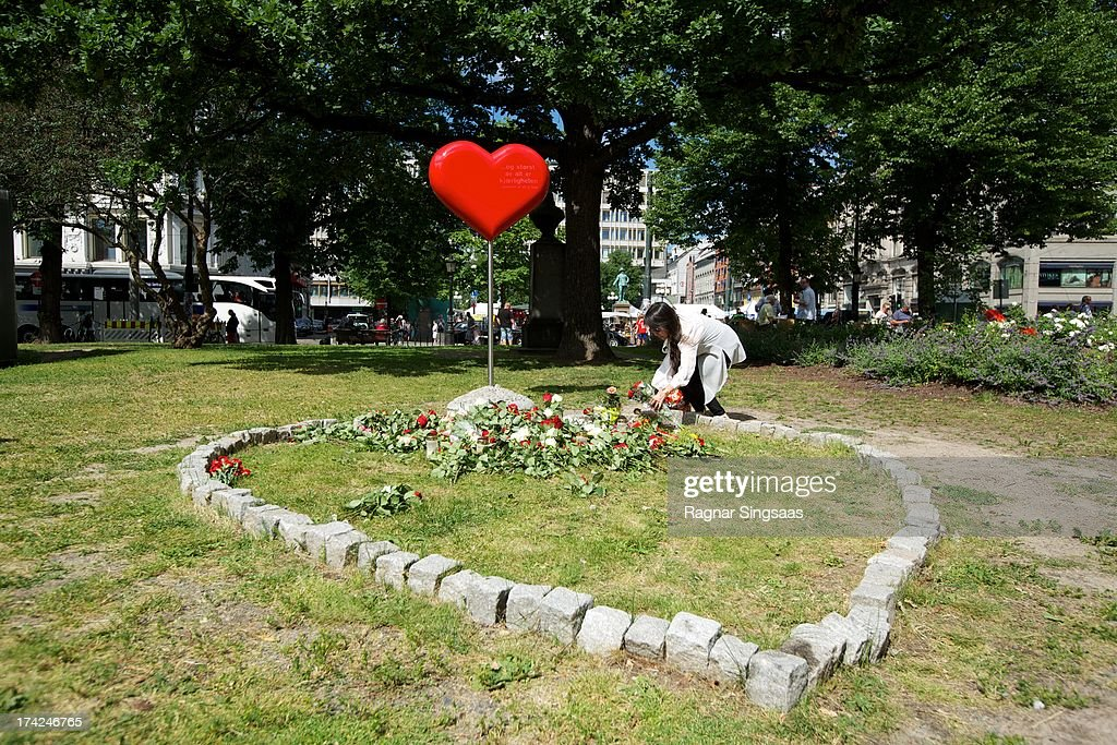 Mourners lay flowers outside Oslo Cathedral in memory of the victims of the 2011 terrorist attacks on July 22, 2013 in Oslo, Norway.