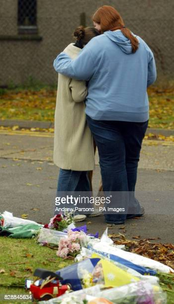 Mourners leave flowers outside Birkbeck School in North Somercotes near Louth Lincolnshire following the stabbing of 14yearold pupil Luke Walmsley A...