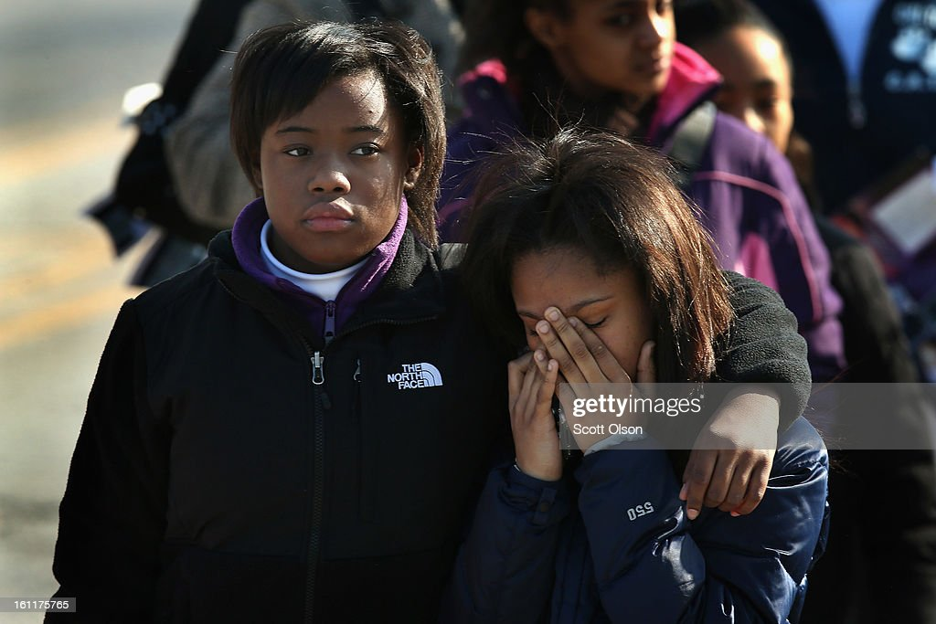 Mourners leave the Greater Harvest M.B. Church following the funeral of 15-year-old Hadiya Pendleton on February 9, 2013, in Chicago, Illinois. Hadiya was killed on January 29, when a gunman opened fire on her and some friends while they were standing under a shelter on a warm rainy afternoon in a park about a mile from President Obama's Chicago home. First lady Michelle Obama attended the funeral with Senior White House Adviser Valerie Jarrett and Secretary of Education Arne Duncan.