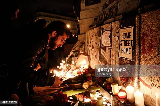 Mourners light candles at a Place de la République in Paris France on Saturday Nov 14 2015 French President Francois Hollande blamed Islamic State...