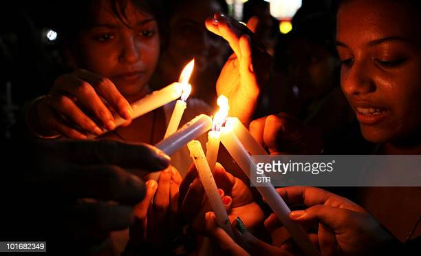Mourners light candles during a vigil for the victims of Air India Express flight 812 in Mangalore on May 24 2010 Investigators on May 24 widened the...