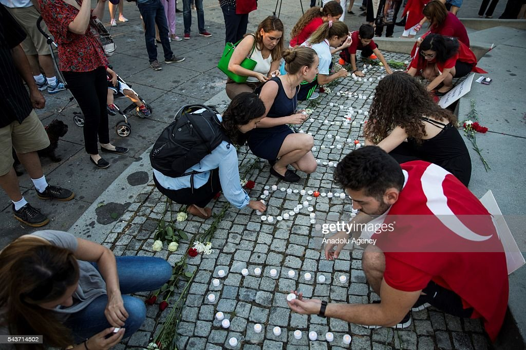 Mourners light candles in Dupont Circle during a vigil for the victims of the Istanbul Airport terrorist attack Washington, USA on June 29, 2016.