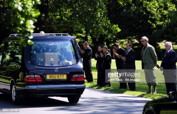 Mourners line the roadside as the cortege carrying the coffin of Lord Harewood is driven through the grounds of Harewood House near Leeds before a...
