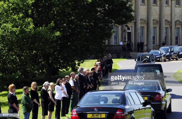 Mourners line the roadside as the cortege carrying the coffin of Lord Harewood is driven past Harewood House near Leeds before a private funeral...