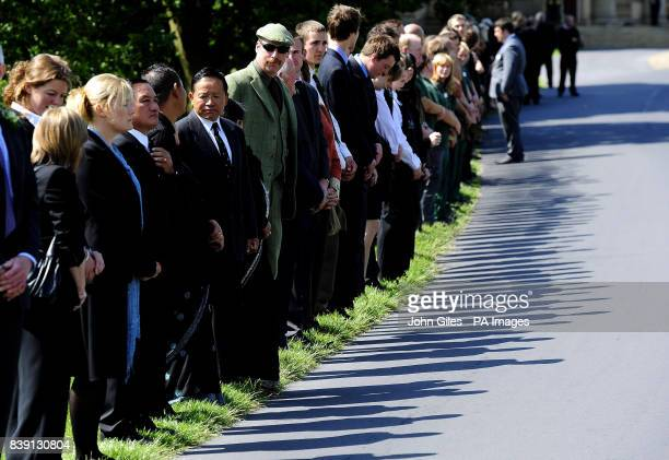 Mourners line the roadside as they wait for the cortege carrying the coffin of Lord Harewood to drive through the grounds of Harewood House near...