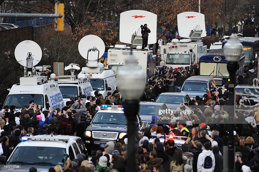 Mourners line the sidewalks of College Avenue on the campus of Penn State, as the procession carries former Penn State Football coach <a gi-track='captionPersonalityLinkClicked' href=/galleries/search?phrase=Joe+Paterno&family=editorial&specificpeople=623059 ng-click='$event.stopPropagation()'>Joe Paterno</a> from the Pasquerilla Spiritual Center to his burial site, January 25, 2012 in State College, Pennsylvania. Paterno, who was 85, died due to complications from lung cancer on January 22, 2012.