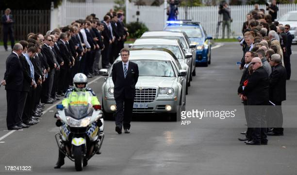 Mourners line the street outside the St Therese's Parish for the funeral of Australian baseball player Chris Lane who was killed in the small...