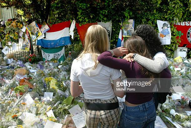Mourners look at flowers outside the house of slain Dutch rightwing politician Pim Fortuyn May 7 2002 in Rotterdam Netherlands Fortuyn was shot and...