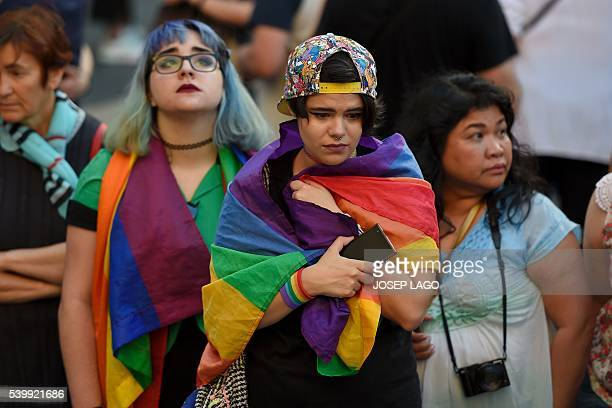 Mourners observe a minute of silence outside Barcelona's city hall during a vigil at Sant Jaume Square in Barcelona on June 13 called by LGTBicat...