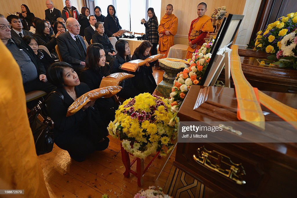 Mourners offer garments at a service of remembrance for three Thai Buddhist Monks who died in a car crash on Christmas Eve, at Oakvale Funeral Home on January 2, 2013 in Edinburgh, Scotland. Abbot Phramaha Pranom Thongphaiboon, 43, head of the Thai Buddhist community in Aberdeen, was killed in a car crash on Christmas Eve along with his colleagues Phramaha Kriangkrai Khamsamrong, 35, and Phramaha Chai Boonma, 36. The three men were travelling to the Dhammapadipa Temple in Edinburgh when they were involved in the head-on collision on the A68 near Pathhead, Midlothian.