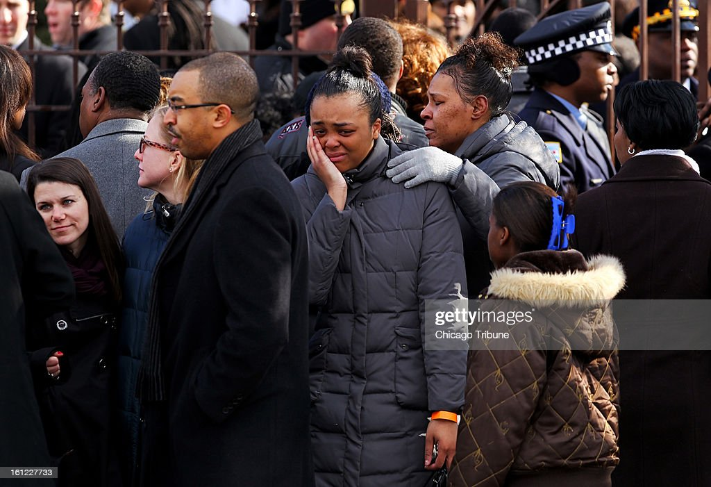Mourners outside Greater Harvest Baptist Church before the funeral service for Hadiya Pendleton on Saturday, February 9, 2013, in Chicago, Illinois. Pendleton, who performed at President Obama's inauguration, was killed January 29 when a gunman fired on a group of students.