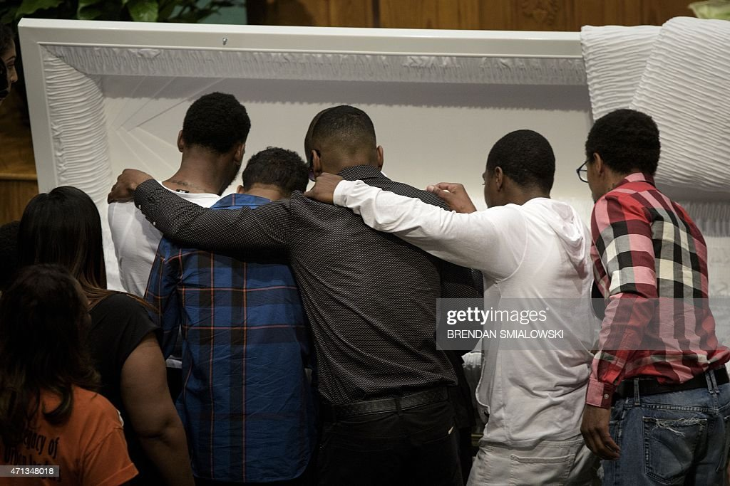 Mourners pay their respects at the casket of Freddie Gray before his funeral at New Shiloh Baptist Church April 27, 2015 in Baltimore, Maryland. Family members and friends are expected to turn out in large numbers Monday at the funeral of Gray, the 25-year-old black man who died April 19 after an encounter April 12 with police left him with grave spinal injuries. PHOTO