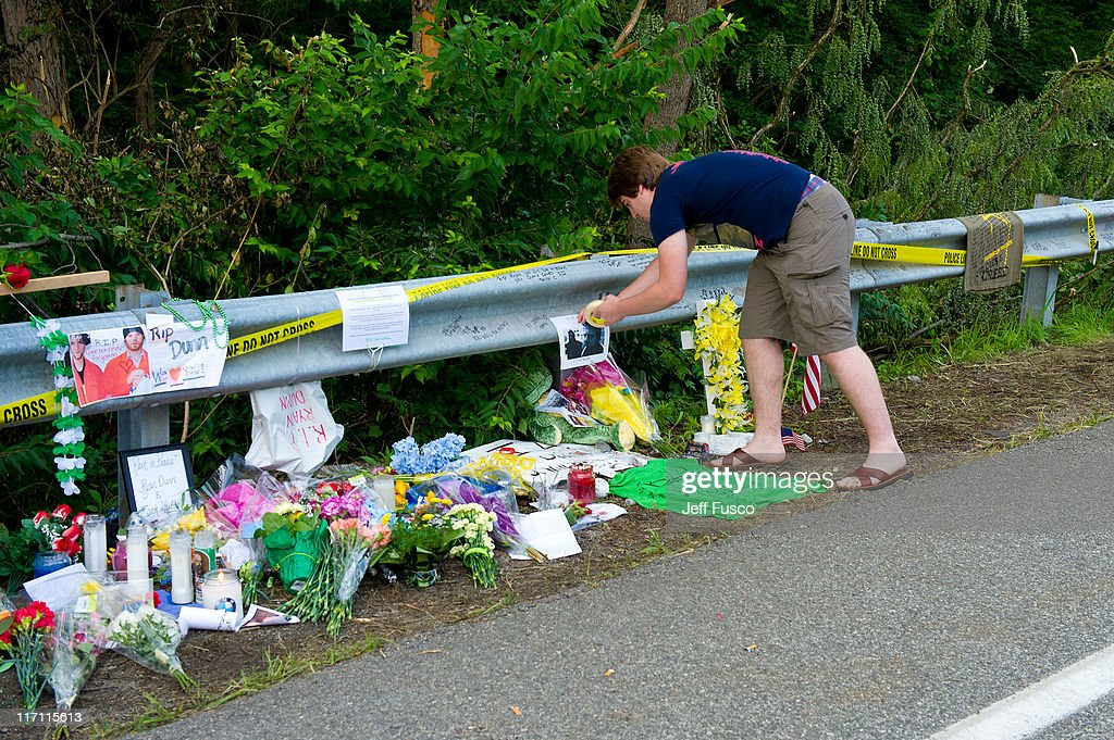 mourners pay tribute at the fatal crash scene wherejackass star ryan dunn and