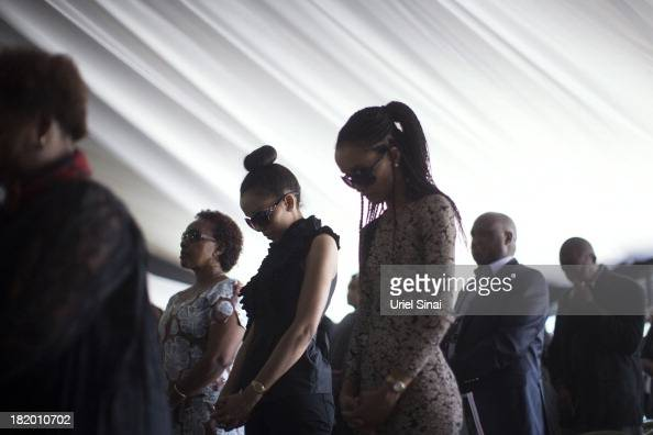 Mourners pray at a funeral service for Kenyan President Uhuru Kenyatta's nephew Mbugua Mwangi and Mwangi's fiancee Rosemary Wahito who were killed at...