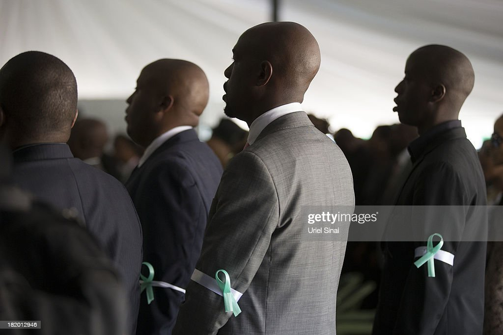 Mourners pray at a funeral service for Kenyan President Uhuru Kenyatta's nephew Mbugua Mwangi and his fiancee Rosemary Wahito who were killed at the the Westgate Mall terrorist attack, on September 27, 2013 in Nairobi, Kenya. The country is observing three days of national mourning as security forces begin the task of clearing and securing the Westgate shopping mall following a four-day siege by militants.