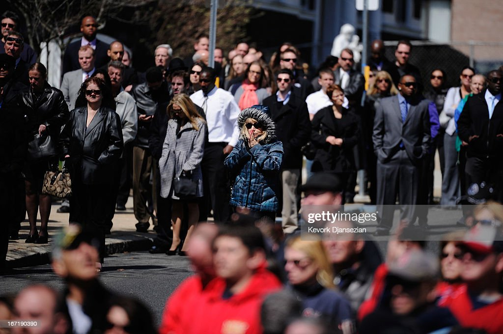 Mourners react as a hearse arrives at St. Joseph Catholic Church for the funeral of Krystle Campbell, a victim of the Boston Marathon bombing, on April 22, 2013 in Medford, Massachusetts. A manhunt ended for Dzhokhar A. Tsarnaev, 19, a suspect in the Boston Marathon bombing after he was apprehended on a boat parked on a residential property in Watertown, Massachusetts. His brother Tamerlan Tsarnaev, 26, the other suspect, was shot and killed after a car chase and shootout with police. The bombing, on April 15 at the finish line of the marathon, killed three people and wounded at least 170.
