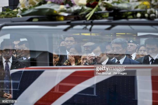 Mourners react as the Union Flag draped coffins containing the bodies of Sapper Darren Foster of 21 Engineer Regiment and Sapper Ishwor Gurung of 36...