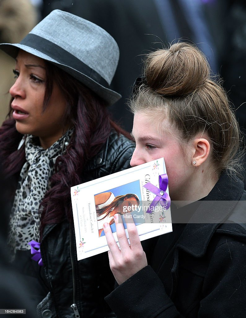 Mourners react as they follow the coffin carrying the body of Christina Edkins as they leave the funeral service at St Phillips Cathedral on March 22, 2013 in Birmingham, England. Hundreds of people attended the service for the teenager, who was stabbed to death on a bus in Birmingham. Leasowes High School, in Halesowen, where the 16-year-old was a pupil, was closed today to allow children and staff to join her family at the service