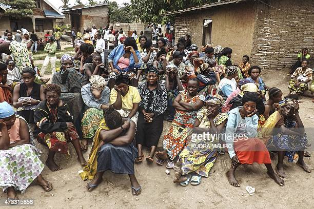 Mourners react as they gather in Mbutaba 23km north of Beni on May 14 after the death of a relative following a massacre allegedly committed by...