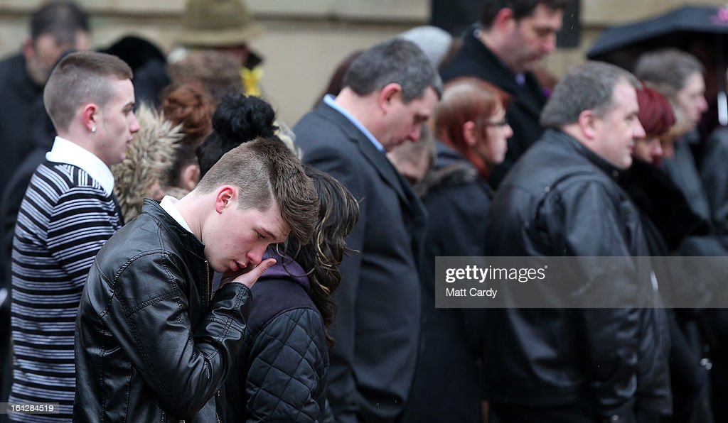 Mourners react as they listen to the funeral service of Christina Edkins at St Phillips Cathedral on March 22, 2013 in Birmingham, England. Hundreds of people attended the service for the teenager, who was stabbed to death on a bus in Birmingham. Leasowes High School, in Halesowen, where the 16-year-old was a pupil, was closed today to allow children and staff to join her family at the service