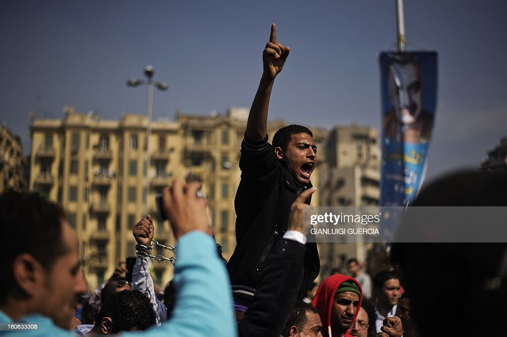 Mourners react during the funeral of killed Egyptian activists Amro Saad and Mohammed al-Guindi outside Omar Makram Mosque in Cairo's Tahrir Square on February 4, 2013. Saad died in clashes during anti-government protests on February 1, while Guindi, 28, went missing last month after joining protests demanding change on the second anniversary of Egypt's uprising against former president Hosni Mubarak and then slipped into a coma following days in police custody, according to the health ministry and his party.