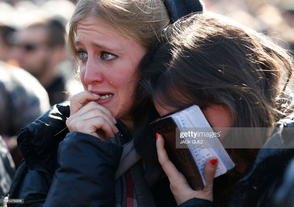 Mourners react in Jerusalem on January 13 2015 during the funeral of four Jews killed in an Islamist attack on a kosher supermarket in Paris last...