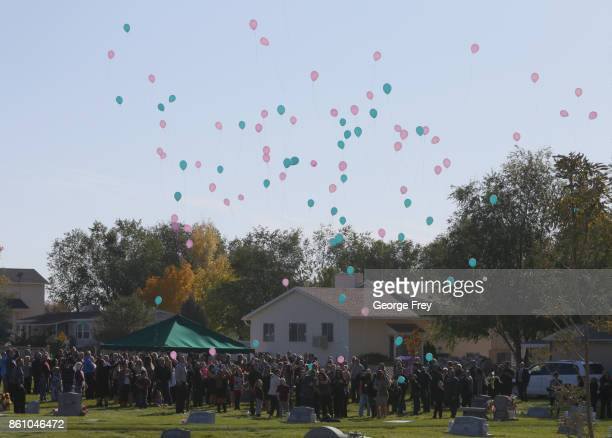 Mourners release balloons after a graveside service of Heather Lorraine Alvarado on October 13 2017 in Enoch Utah Alvarado was a 35 year old wife and...