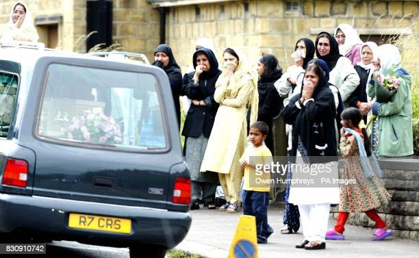 Mourners show emotion as eight hearses leave the street in Huddersfield where eight members of the same Asian family were killed in an arson attack...