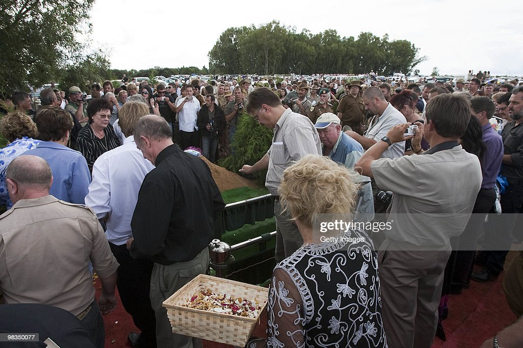 Mourners show show their respect by placing earth on the grave as they attend the funeral of Afrikaner Resistance Movement (AWB) slain leader Eugene Terre'Blanche on April 9, 2010 in Ventersdorp, South Africa. Some 3,000 people attended the funeral of the white supremacist who was murdered last Saturday at his farm. Two of Terrblanche's employees have been charged with his murder.